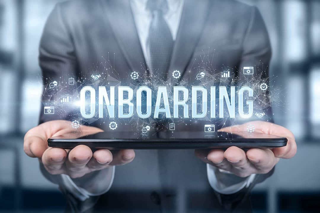 Businessman Shows On The Tablet The Word Onboarding .